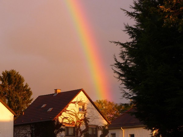Rainbow Over A House At Sunset