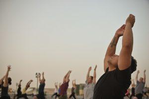 men doing yoga for back pain